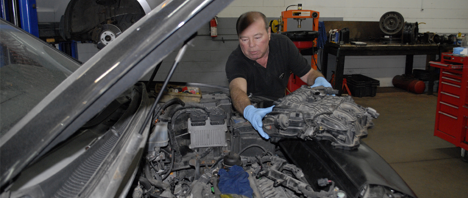 Darrell Hebb working on a vehicle